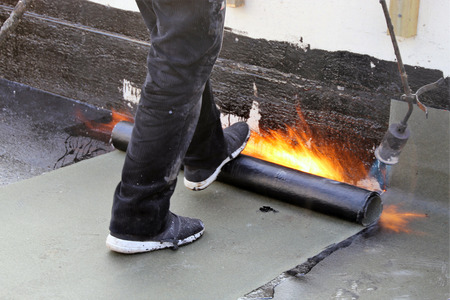 Waterproofing flat roof with bitumen sealing membranes Stock Photo