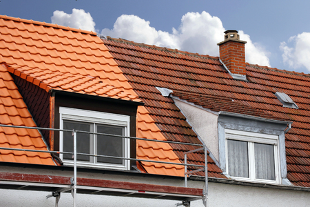 Semi-detached house with old roof and roof Stock Photo