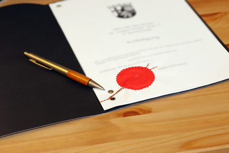 Notarized agreement with red official seal Фото со стока