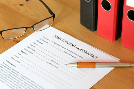 Blank form of an employment agreement on a desk
