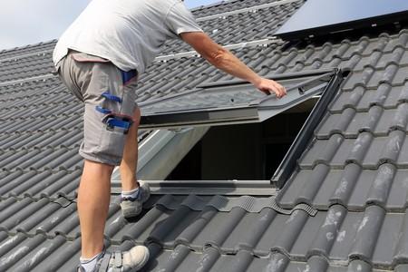 Roofer installing a skylight