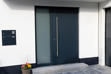 Modern new anthracite gray front door
