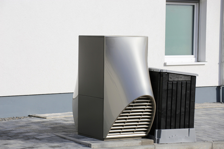 Heat pump on a residential home Archivio Fotografico