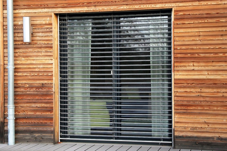 Window with modern blind, exterior shot