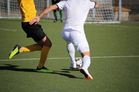 Soccer players in action, close-up