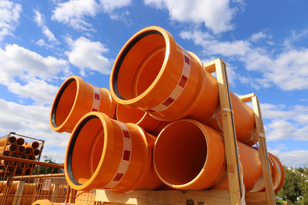 Pile of tubes (kg sewer pipes) on a building site