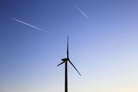 Wind turbines, wind farm at the sunrise Stock Photo