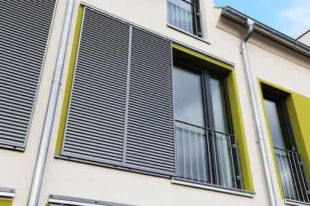 Windows with modern sliding shutters