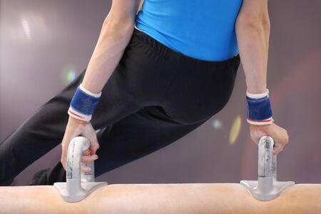 Detailed view of a gymnastic on the pommel horse Foto de archivo - 125619407