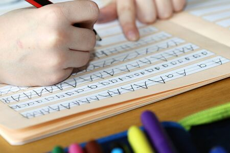 First grader learns writing Stock fotó