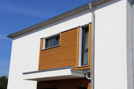 Modern facade with wooden panels