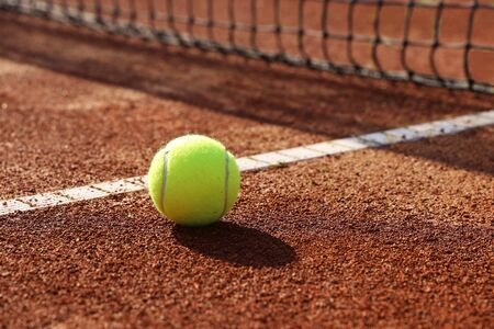 Tennis court with ball and net, close-up
