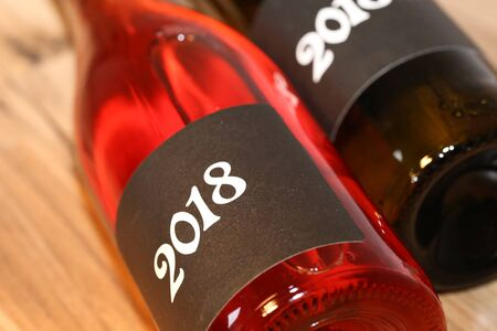 Close up of two lying wine bottles Stock Photo