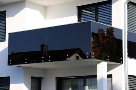 Black balcony rails made of glass and stainless steel