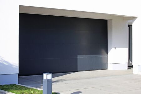 Modern new garage door (sectional door) Foto de archivo