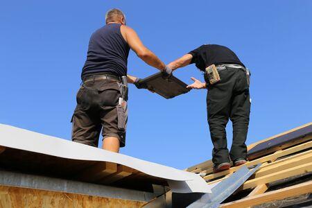 New roof covering in progress 写真素材