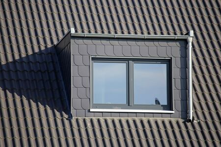 Slate cladded dormer on a new tiled roof
