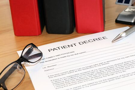Blank form of a patient decree on a desk Stock Photo