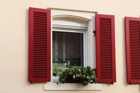 Window with red wooden shutter 版權商用圖片