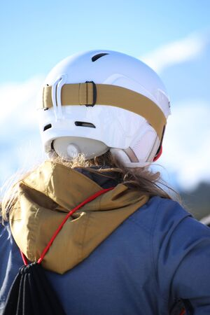Close up of a female skier from behind