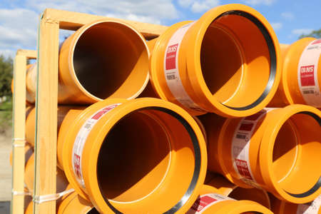 Pile of tubes (kg sewer pipes) on a building site (Mutterstadt, Germany, May 15, 2019)