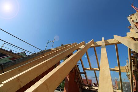 Wood construction and carpentry work on a new residential house Archivio Fotografico