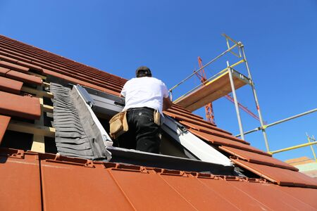 Installation and assembly of new roof windows as part of a roof covering Foto de archivo