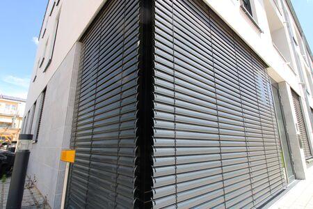 Window with external venetian blind, exterior shot Stock Photo