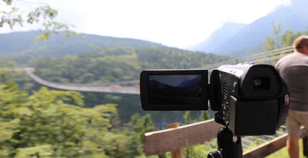 Close up of a camcorder during video recordings in the Alps