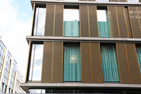 Urban building with modern wooden sliding shutters Editorial