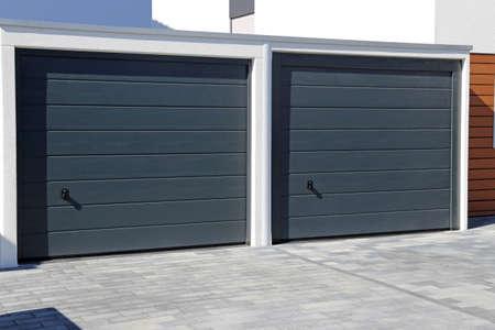 Two modern new garage doors (sectional doors) Stockfoto