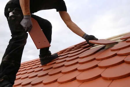 Roofing work, new covering of a tiled roof Standard-Bild