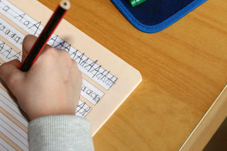 Symbol image: First grader learns writing