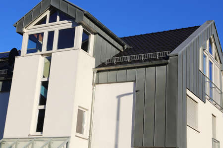 Residential home with modern standing seam facade Banco de Imagens