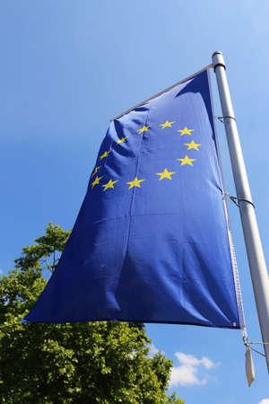 Flag of the European Union in front of a blue blue sky Foto de archivo