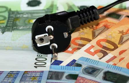 Symbol image electricity costs with european banknotes Banco de Imagens