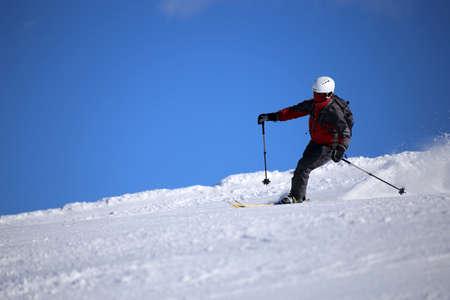 Sporty skier riding the slope Banco de Imagens