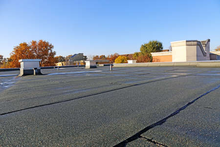 Building with newly renovated flat roof sealing