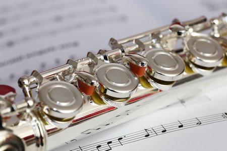 Symbol image: Transverse flute on music notebook