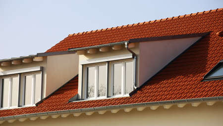 Large dormer on a newly tiled roof