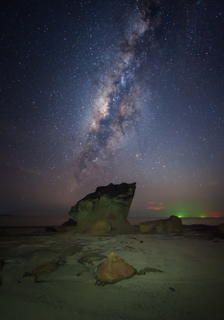 rise above: milkyway rise above a rock