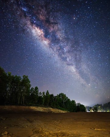 rise above: bright milky way rise above dry land Stock Photo