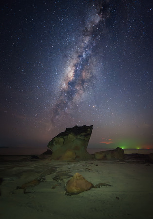 standing stone: milky way galaxy rise above a standing stone Stock Photo