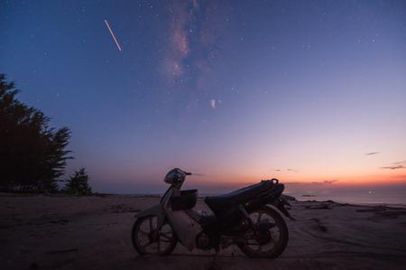 motobike: motobike by the sea during sunset Stock Photo