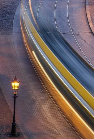 A moving tram at night Standard-Bild