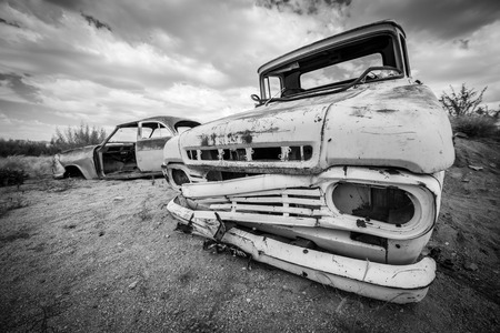 damaged car: Scrap vintage car in the desert in Namibia Stock Photo