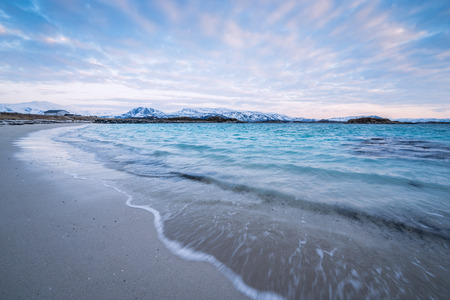 Waves crashing on the beach in Sommaroy, Norway