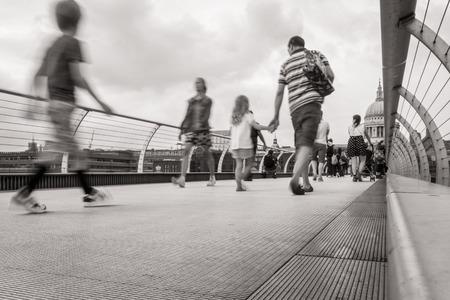 People walking over Millennium bridge  Standard-Bild