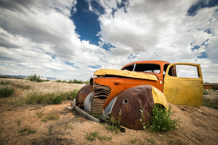 Scrap vintage car in the desert in Namibia photo