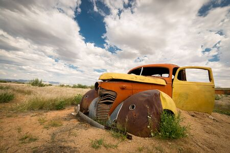 This photograph of a colourful abandoned vintage car was taken in Solitaire, which is a small settlement in the Khomas Region of central Namibia.